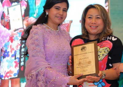 Norita Omar won her first international award, Iconic Woman Creating a Better World at Women Economic Forum in India